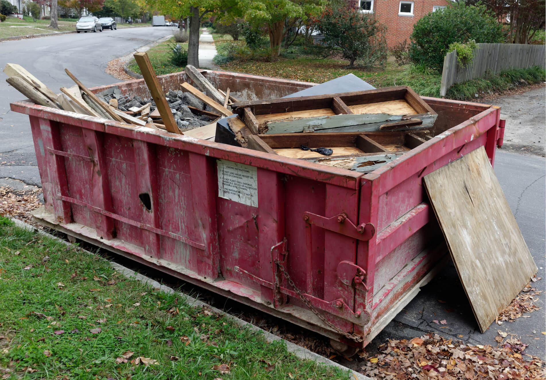red dumpster on street