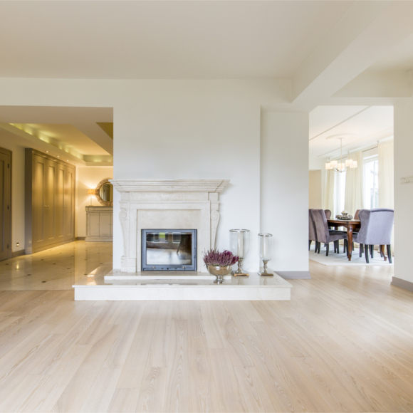 white living room with light wood floors