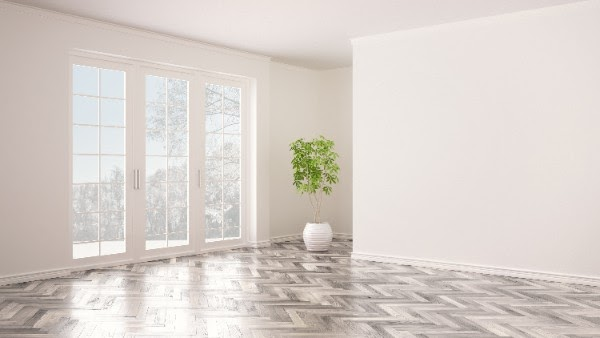 gray herringbone hardwood floor pattern in room with french doors