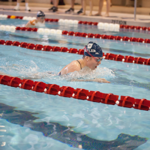 Woman swimming in a race