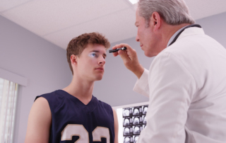 Football Player at the Doctor