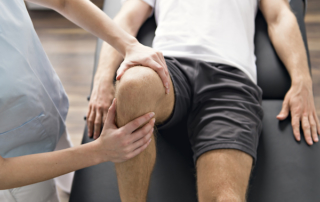 Man getting his knee checked out by an orthopedic surgeon