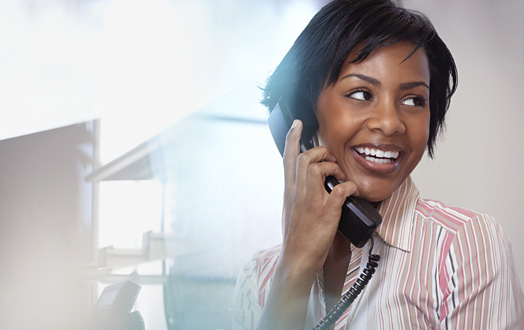 woman smiling talking on phone