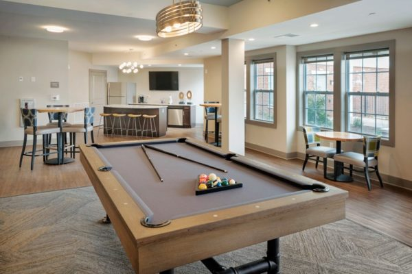 beautiful lounge area at Summit Court with pool table and tables and chairs