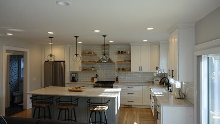 white cabinets with subway tile as back splash