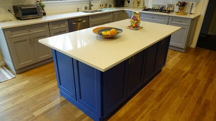 navy blue island with white counter top