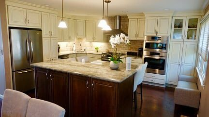 2 tone kitchen with dark brown island and off white cabinets