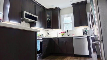 dark brown cabinets with white back splash