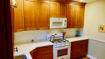 light brown cabinets with off white counters