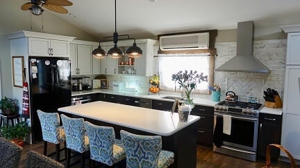 two toned kitchen cabinetry with white and black