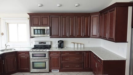 dark brown kitchen cabinets with white counter tops
