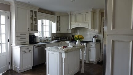 white cabinet kitchen with small island