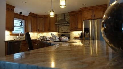 brown cabinetry with beige counter tops