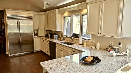 off white kitchen cabinets with grey vein counter tops