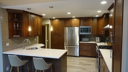 brown cabinets with white counter tops