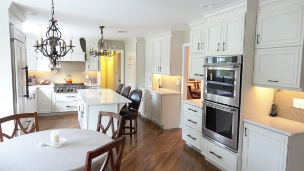 Open concept kitchen with high end finishes and wet bar