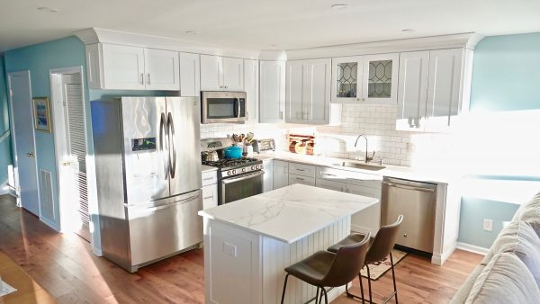 Newly remolded kitchen with stainless steel appliances and white marble countertop
