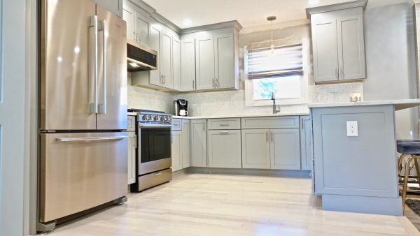 Dusty light blue kitchen cabinets with high end finishes