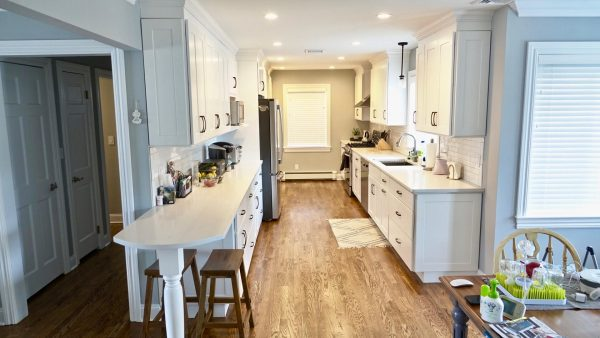 Newly renovated kitchen with white cabinets and countertops