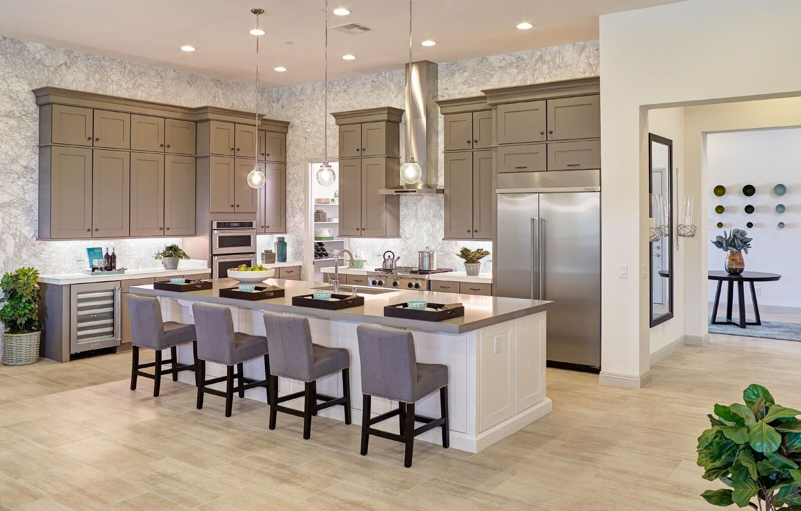 gray kitchen cabinets with white island