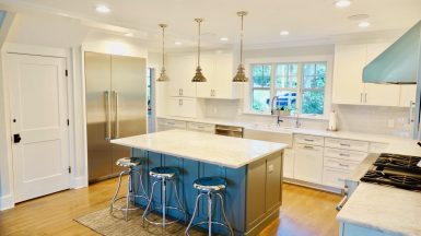 two tone kitchen white cabinets and blue island