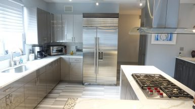 modern galley kitchen with light brown cabinets