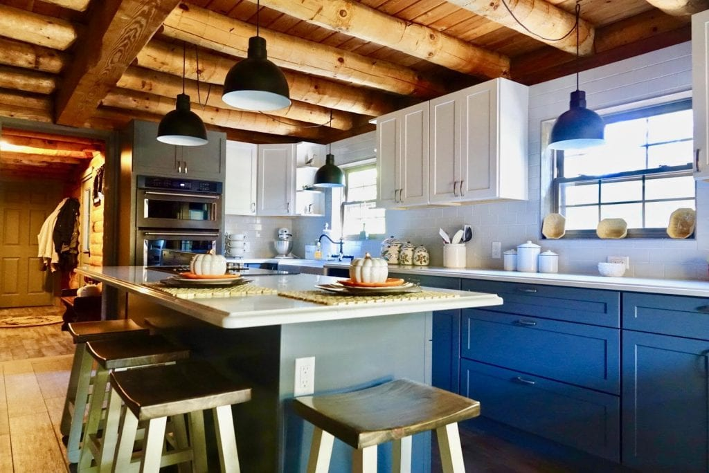 rustic 3 tone kitchen with blue, gray, and white cabinets