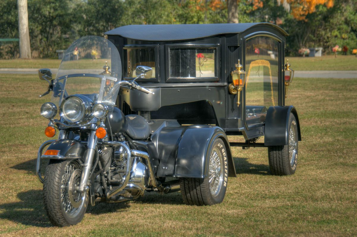 hearse driven by a motorcycle