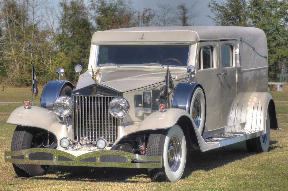 front view of white rolls royce hearse