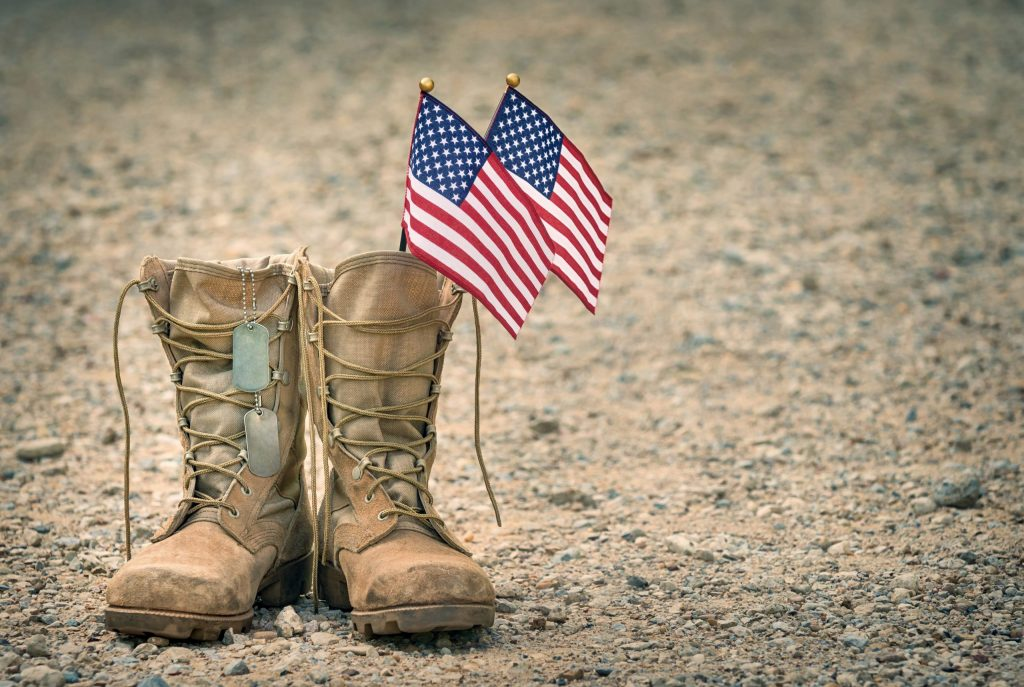 American flags inside military boots