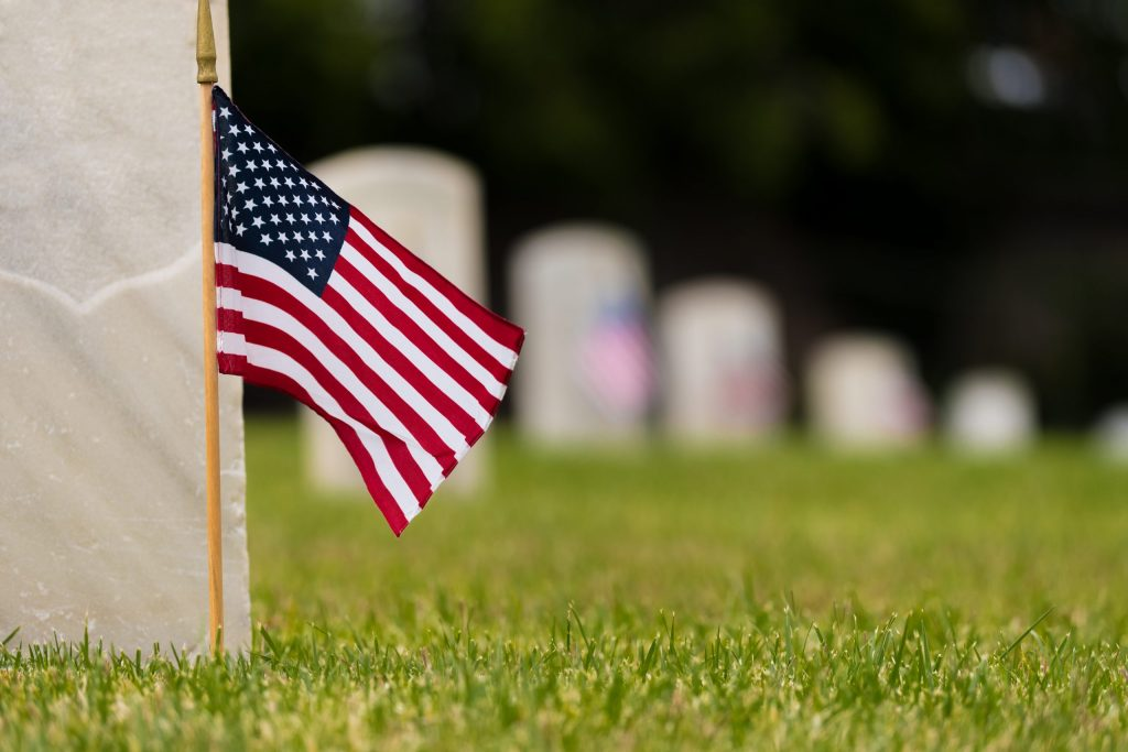 American flag in front of gravestone