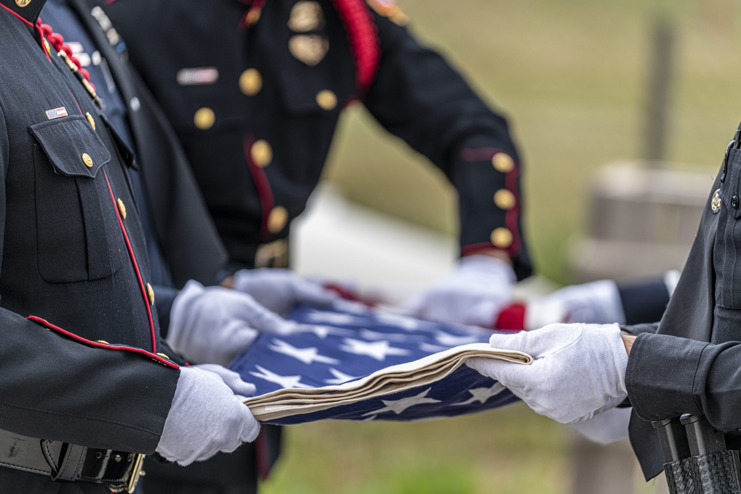 Six Person flag fold of an American Flag at a funeral for a fallen hero