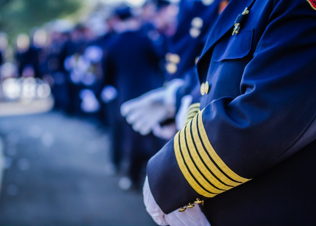 Men in uniforms at funeral service