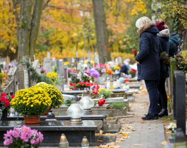 People visiting cemetery