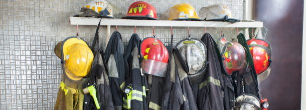fire fighter helmets and jackets hung up