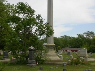 large monumental headstone in a cemetery