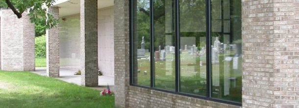 headstones in the window reflection