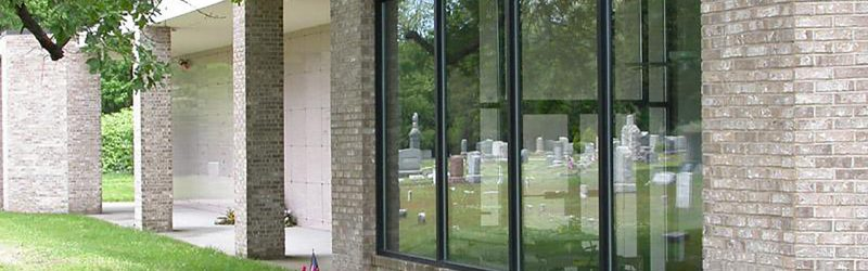 headstones image in a window reflection