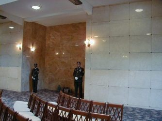 service men and seating inside a mausoleum