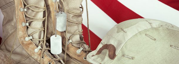 army boots army uniform and american flag in the background